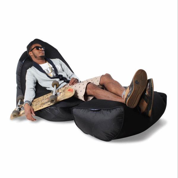 Air mesh bean bag in Gangsta Black 3/4 view with model and skateboard
