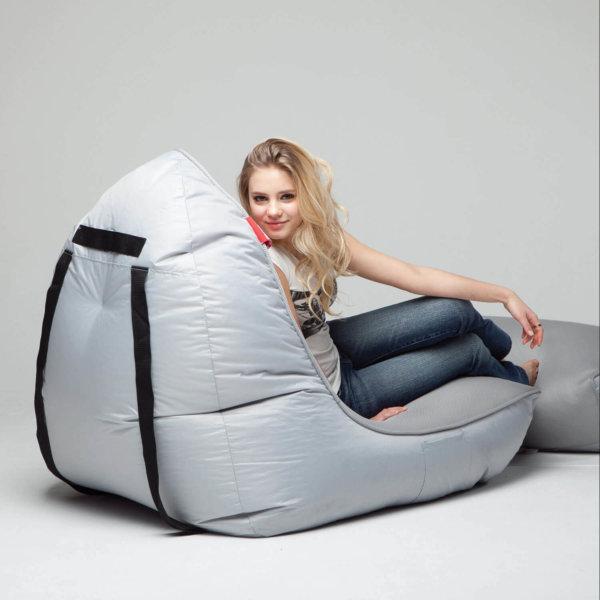 Air mesh bean bag set in shady grey rear 3/4 shot with model