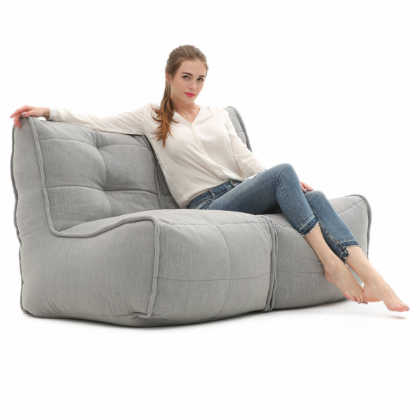 Twin couch designer bean bag sofa in Keystone Grey with model