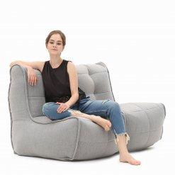 Twin couch designer bean bag sofa in Keystone Grey with model shot 2
