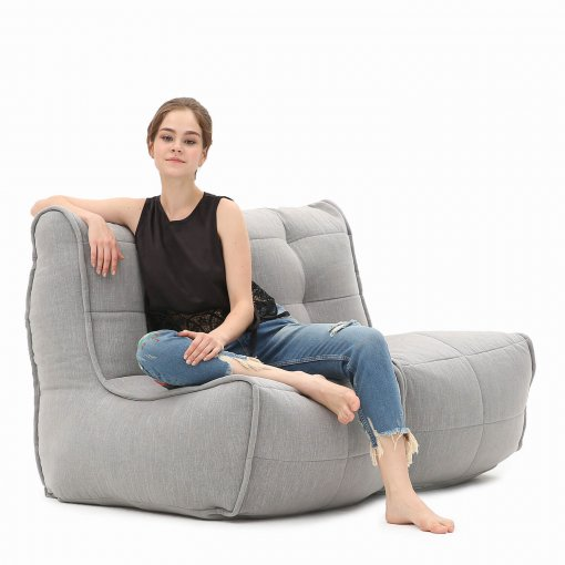 Twin couch designer bean bag sofa in Keystone Grey with model shot 2