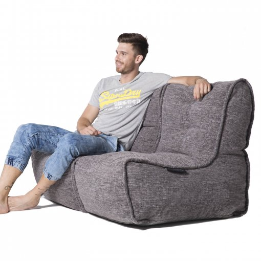 Twin couch in luscious grey fabric with model