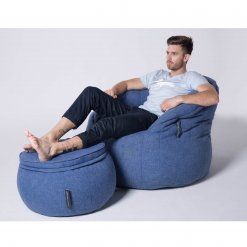 Wing ottoman in blue jazz fabric with butterfly sofa and model