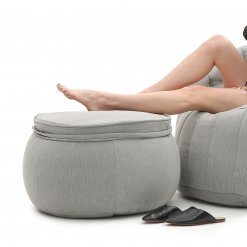 Wing ottoman bean bag in Keystone Grey with models legs